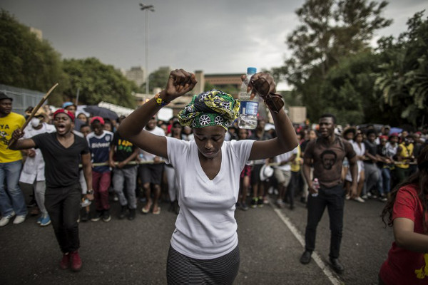 Students demonstrating against university fees and wearing white t-shirt the WITS University Student Representative Council president Nompendulo Mkhatshwa. Photo credit: AFP / Marco Longari